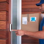 male-courier-delivering-package-to-house-ringing-are-video-doorbells-easy-to-steal